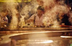 Customers enjoy Hot Pot in Chongqing, China.