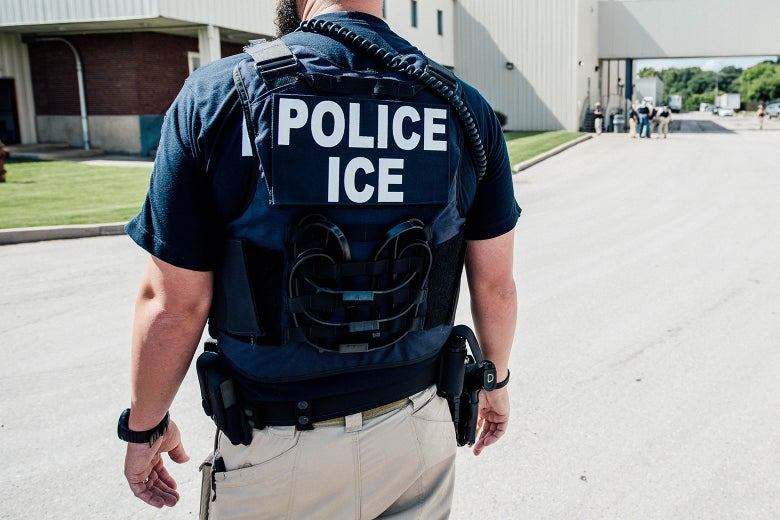 An Immigration and Customs Enforcement special agent prepares to arrest alleged immigration violators at Fresh Mark in Salem, Ohio on June 19.