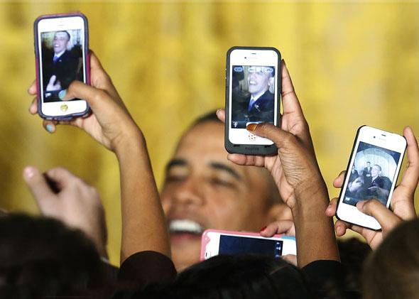 Attendees photograph President Obama with their mobile phones at a Women's History Month reception at the White House in Washington, March 18, 2013.