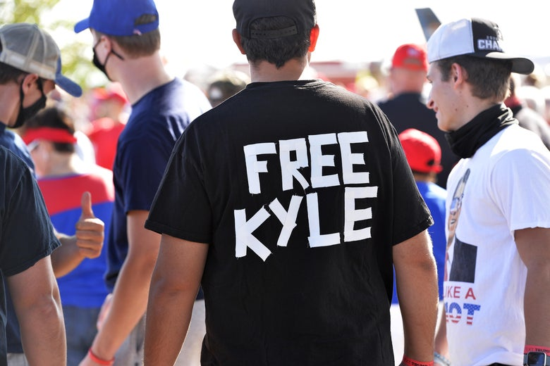 A man wears a shirt calling for freedom for Kyle Rittenhouse, 17, the man who allegedly shot protesters in Wisconsin, during a President Donald Trump campaign rally at Manchester airport in Londonderry, New Hampshire on August 28, 2020.