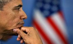 President Obama listens to remarks from French President Francois Hollande in St. Petersburg September 6, 2013.
