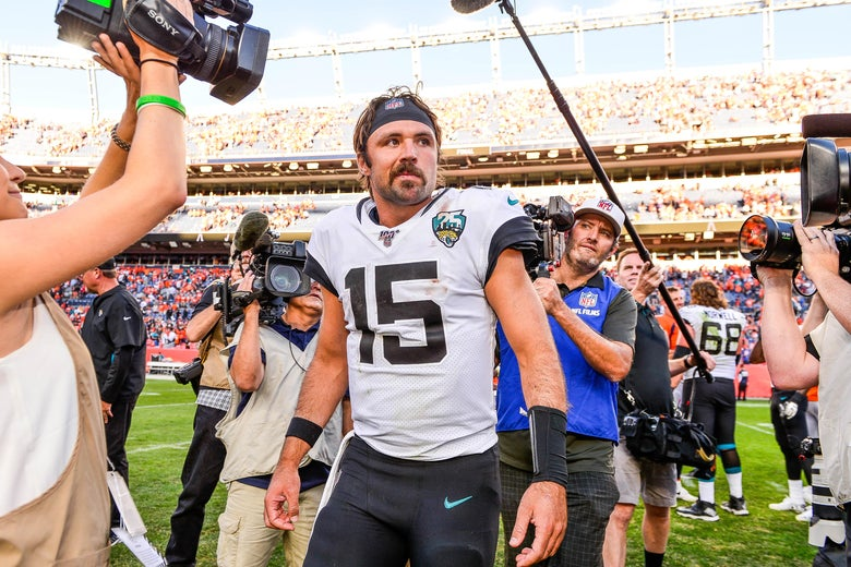 DENVER, CO - SEPTEMBER 29:  Gardner Minshew #15 of the Jacksonville Jaguars walks on the field after a 26-24 lion over the Denver Broncos at Empower Field at Mile High on September 29, 2019 in Denver, Colorado. (Photo by Dustin Bradford/Getty Images)