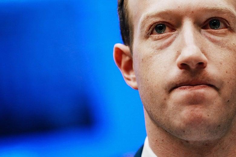 Close-up of Facebook CEO Mark Zuckerberg looking sheepish while testifying before Congress.