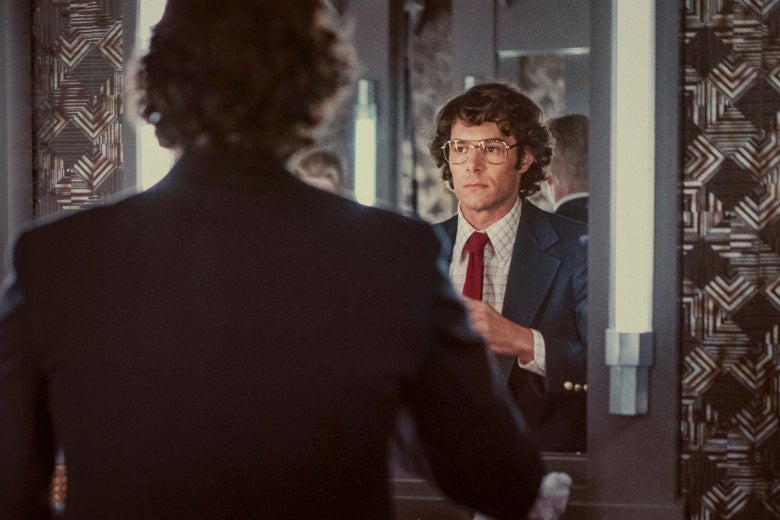 Adam Brody looks into a mirror as Marc Feigen Fasteau.