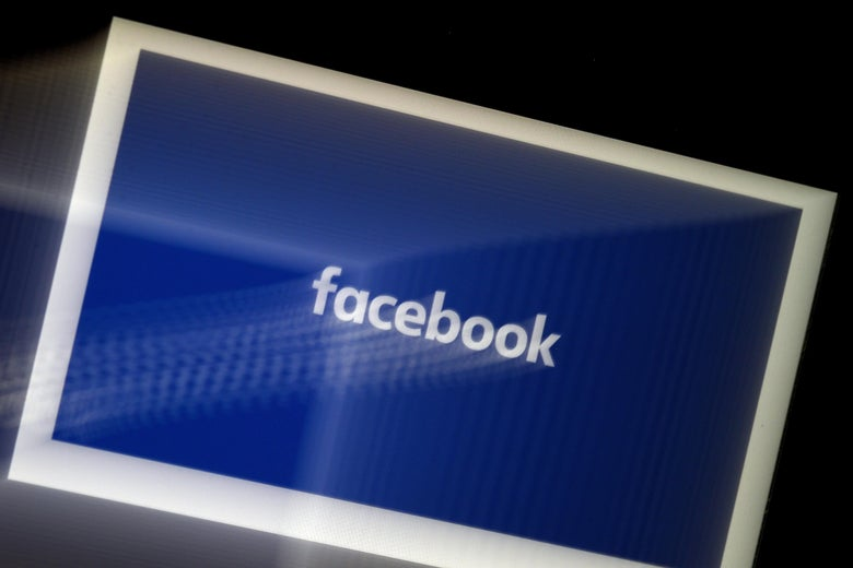 A blurred image of the Facebook logo on a tablet