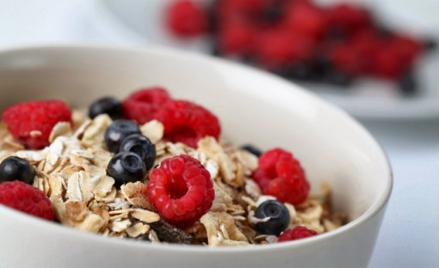 Granola with raspberries and blueberries.