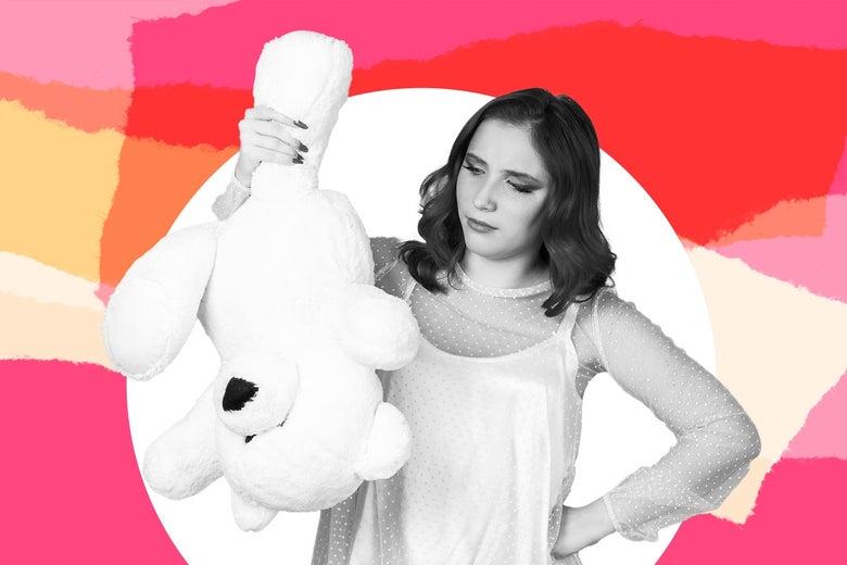 A woman holds a stuffed animal.