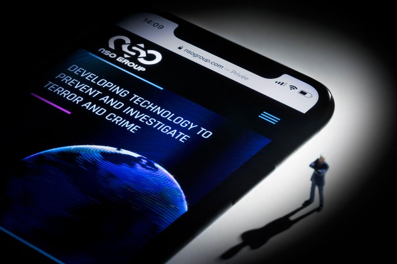 This studio photographic illustration shows a smartphone with the website of Israel's NSO Group which features 'Pegasus' spyware, on display.