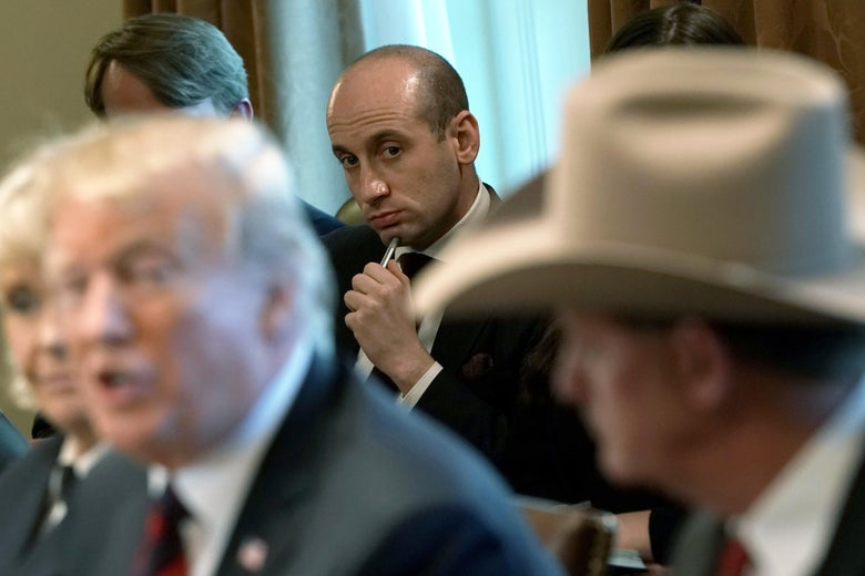 President Donald Trump speaks as senior adviser Stephen Miller (C) listens during a round-table discussion on border security and safe communities at the White House on January 11, 2019 in Washington, D.C.
