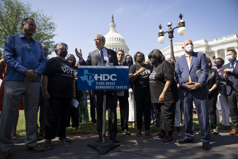 Democratic Texas state representatives at hold a press conference with the U.S. Capitol in the background.