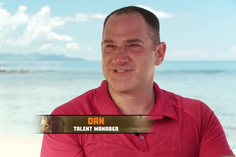 A shoulders up shot of Dan Spilo, sitting on the beach with the ocean behind him, wearing a red polo shirt, from a Survivor talking head interview.