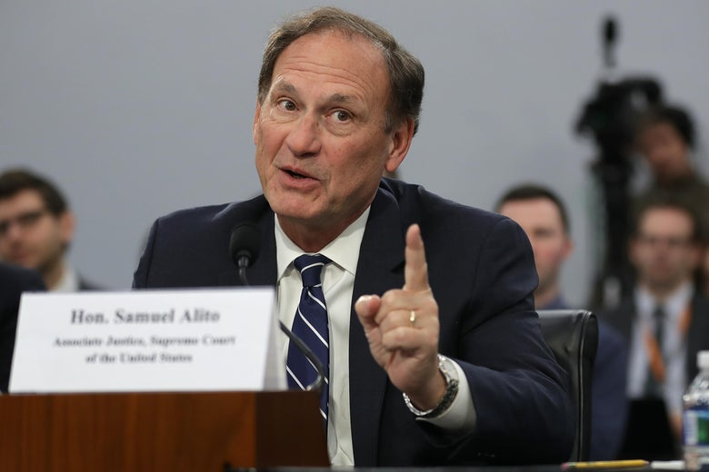 Samuel Alito speaks and gesticulates.