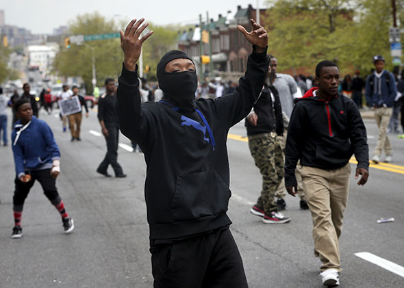 Demonstrators yell at Baltimore police during clashes in Baltimore, Maryland April 27, 2015.