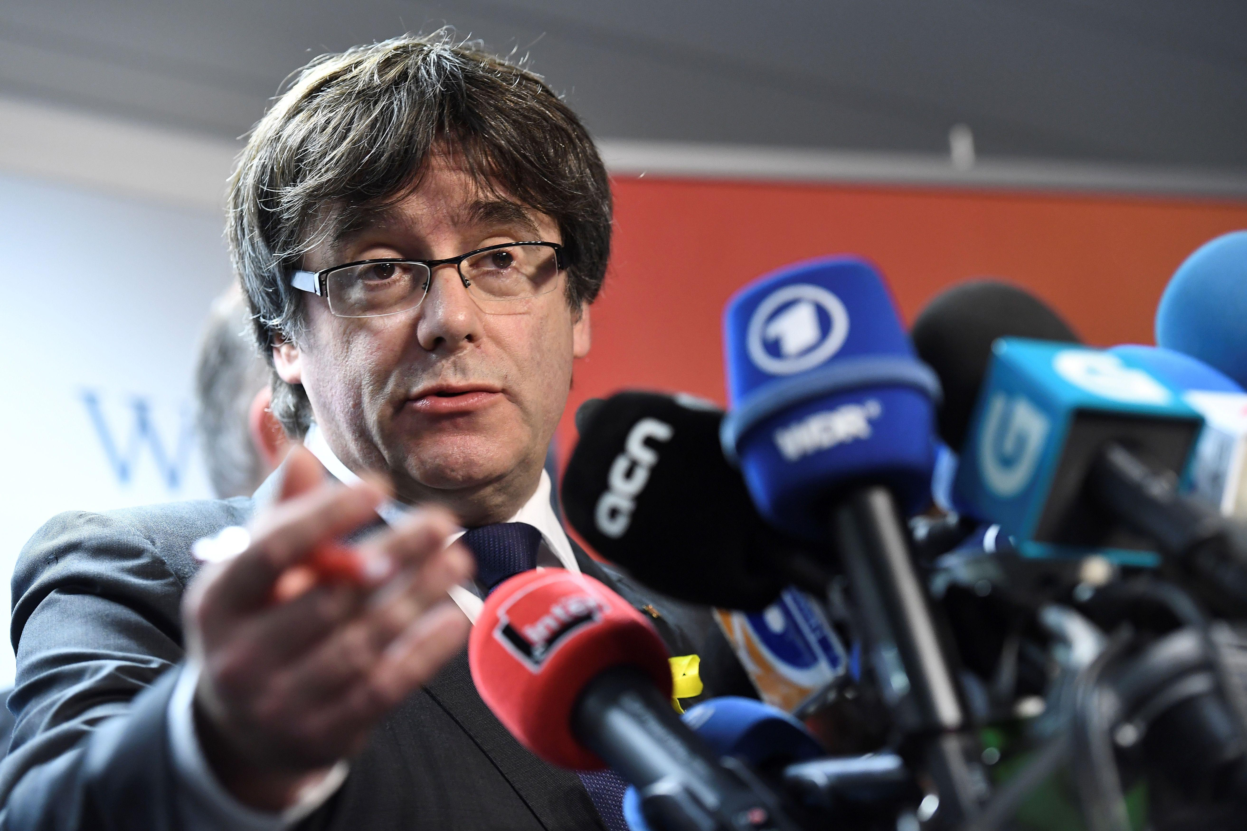 Axed Catalan president Carles Puigdemont gives a press conference on December 22, 2017 in Brussels, a day after the Catalonia's regional election.          Catalans flooded to the polls in a crucial election that could mark a turning point for their region, just two months after a failed secession bid triggered Spain's worst political crisis in decades.  / AFP PHOTO / EMMANUEL DUNAND        (Photo credit should read EMMANUEL DUNAND/AFP/Getty Images)