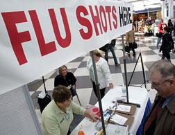 People line up for flu shots. Click image to expand.