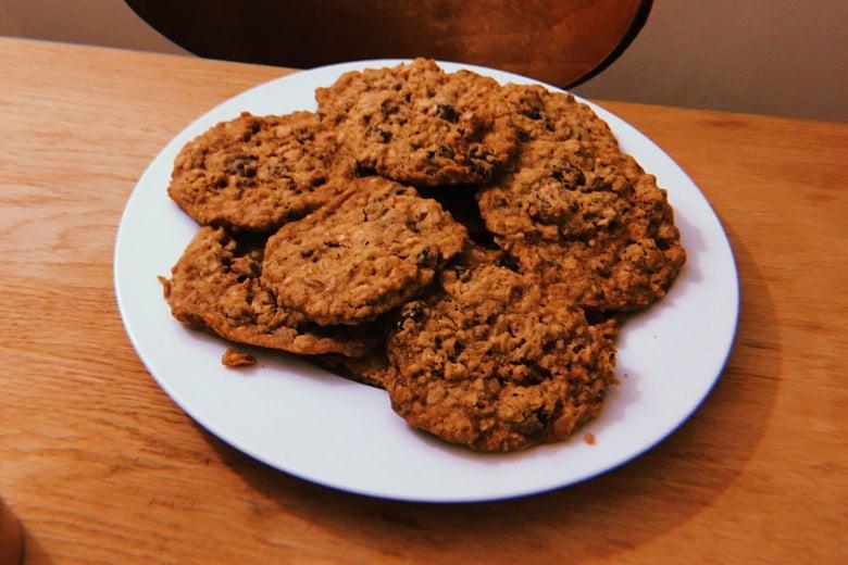 Oatmeal raisin cookies on a plate.