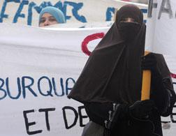 French woman wearing a burqa. Click image to expand.
