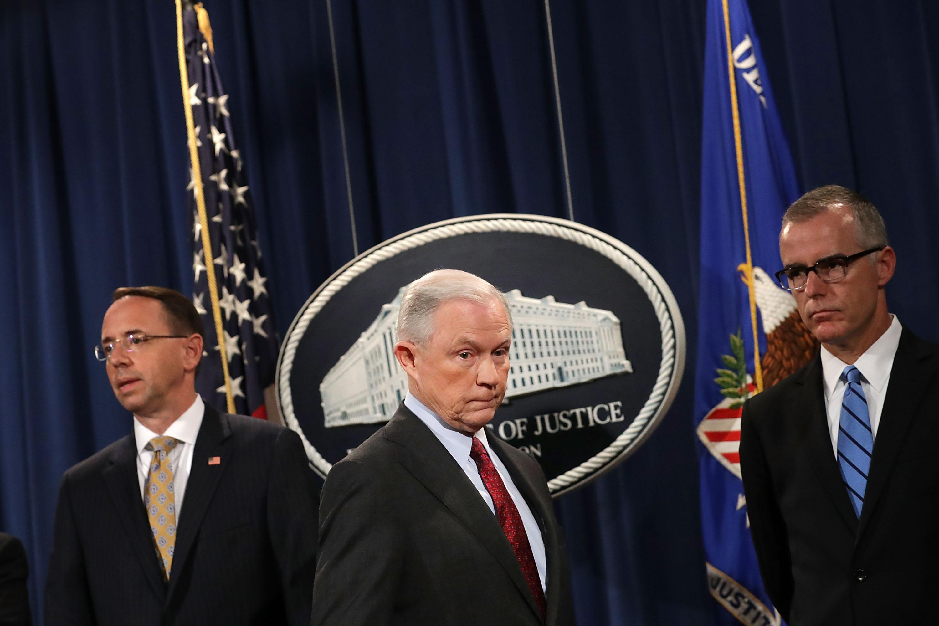 WASHINGTON, DC - JULY 20:  (L-R) Deputy Attorney General Rod Rosenstein, U.S. Attorney General Jeff Sessions, Acting FBI Director Andrew McCabe other law enforcement officials hold a news conference to announce an 'international cybercrime enforcement action' at the Department of Justice July 20, 2017 in Washington, DC. President Donald Trump said Wednesday in an interview with the New York Times that he never would have appointed Sessions had he known Sessions would recuse himself from overseeing the investigation into Russian interference in the 2016 presidential election. 'Sessions should have never recused himself, and if he was going to recuse himself, he should have told me before he took the job and I would have picked somebody else,' Trump said.  (Photo by Chip Somodevilla/Getty Images)