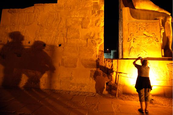 Tourists take pictures as they walk inside the Luxor Temple in Luxor city, around 650 km (404 miles) south of Cairo, December 4, 2010.