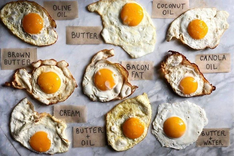 Nine fried eggs labeled with frying method. Clockwise from top left: olive oil, butter, coconut oil, canola oil, butter + water, butter + oil, cream, brown butter, bacon fat.