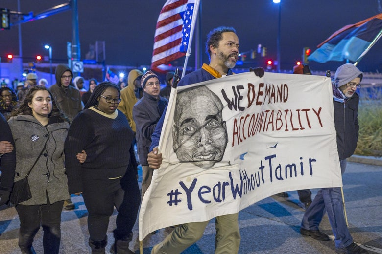 Demonstrators march on Ontario St. on December 29, 2015 in Cleveland, Ohio.