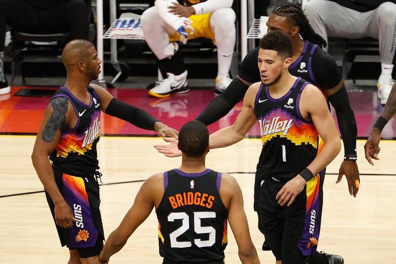 The Suns' Chris Paul, Devin Booker, Mikal Bridges, and Jae Crowder high-five each other