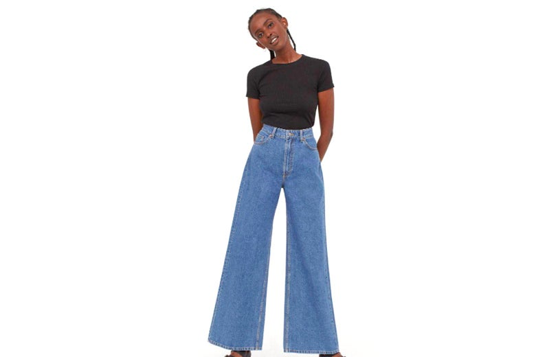 A woman wearing a pair of baggy jeans