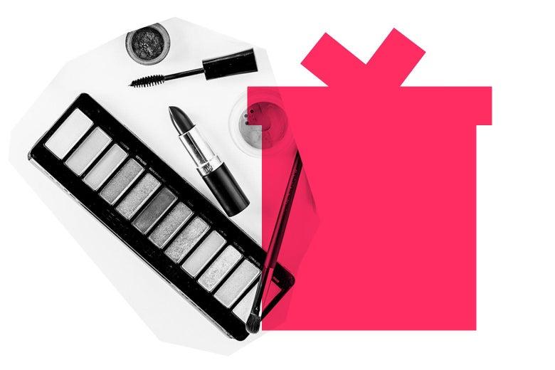 A makeup set against a gift box illustration.