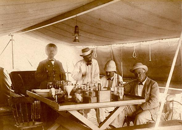 Alex Agassiz (far right), Alfred Mayor (second from right), and William Woodworth (third from right) on board the Croydon, 1896.