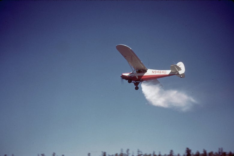 A plane drops fish over a high-elevation lake in Utah