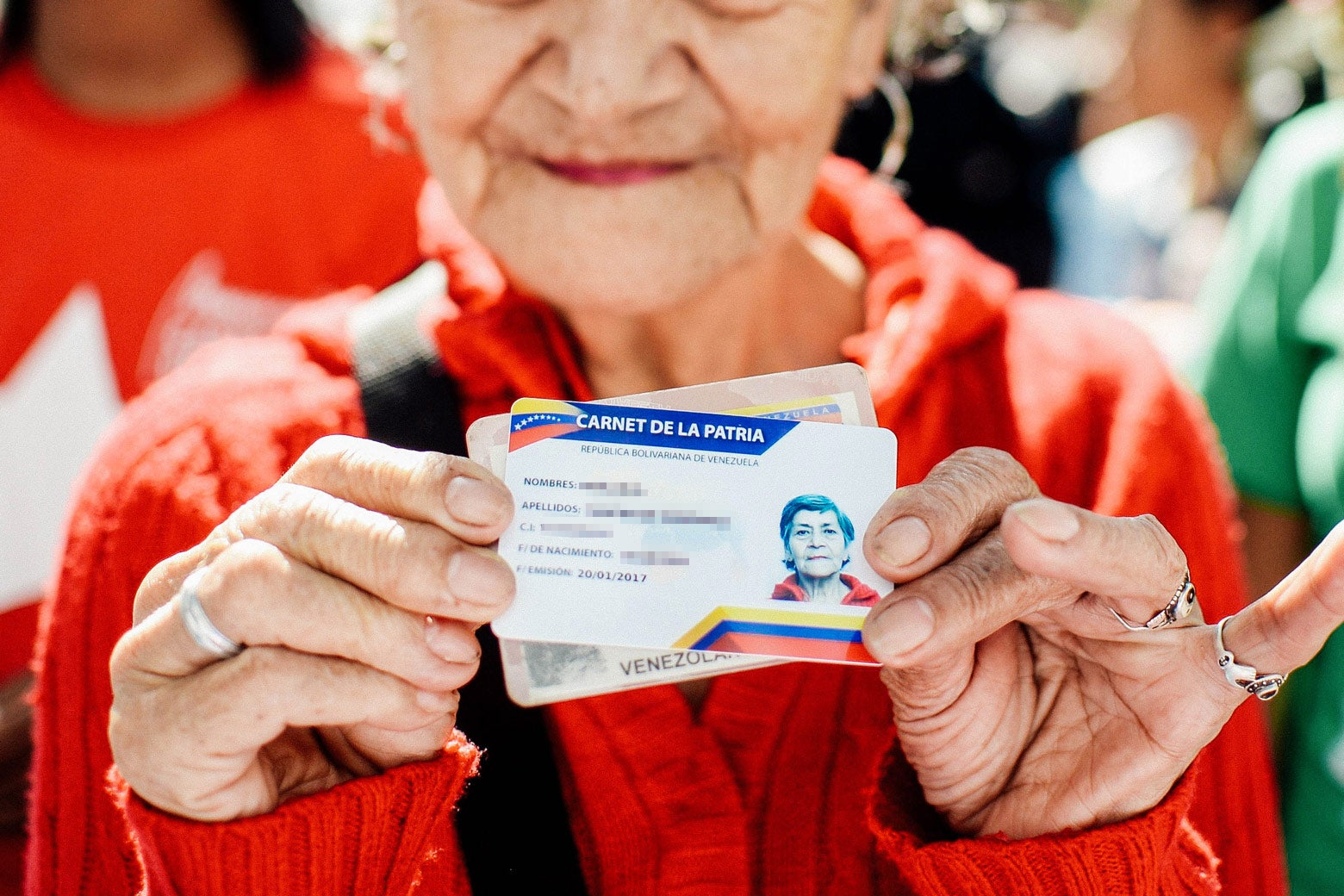 A woman holds up her card.