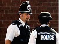 Police stand guard in the Burley area of Leeds. Click image to expand.