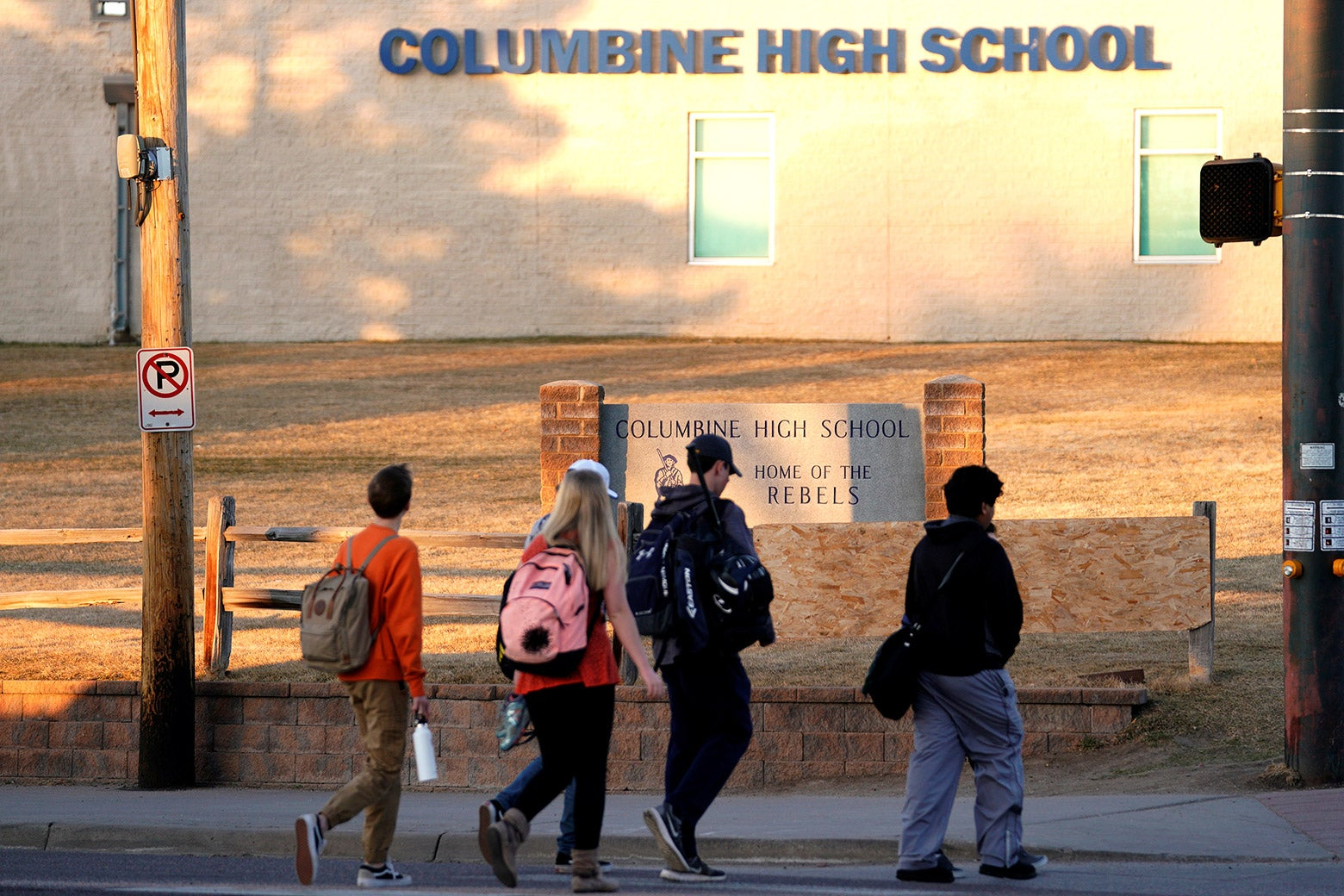Students arrive for class at Columbine High School on March 14, 2018.