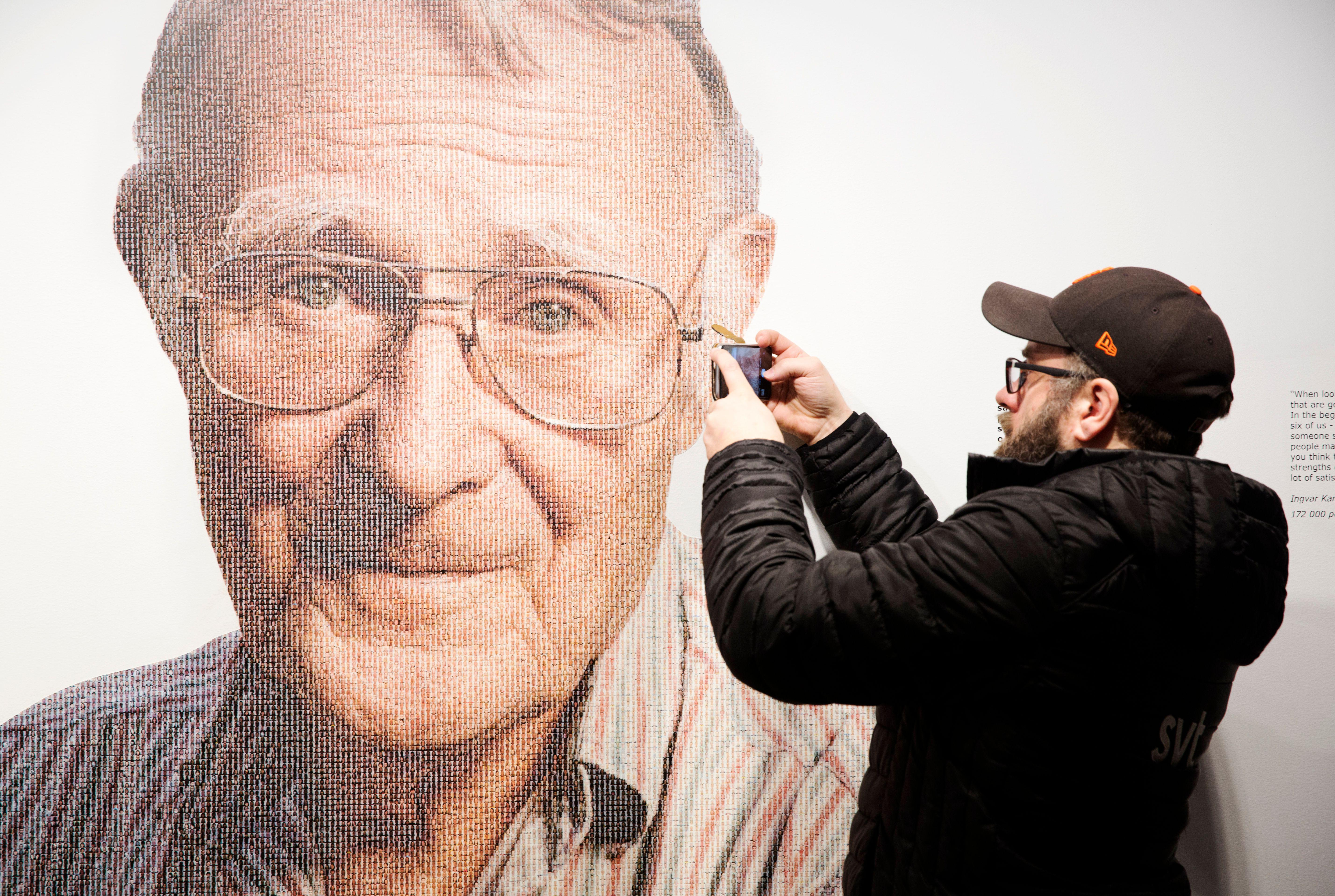 A visitor takes a mobile photo of a picture of Ingvar Kamprad, founder of Swedish multinational furniture retailer IKEA, at the IKEA museum in Almhult, Sweden, on January 28, 2018. Ingvar Kamprad, the enigmatic founder of Swedish furniture giant IKEA, died aged 91 on Sunday, the company said.