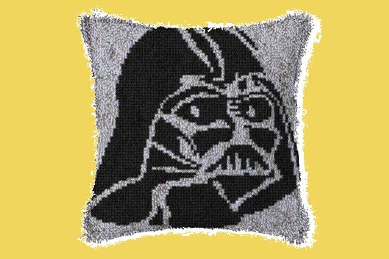 A Darth Vader design on a pillow.