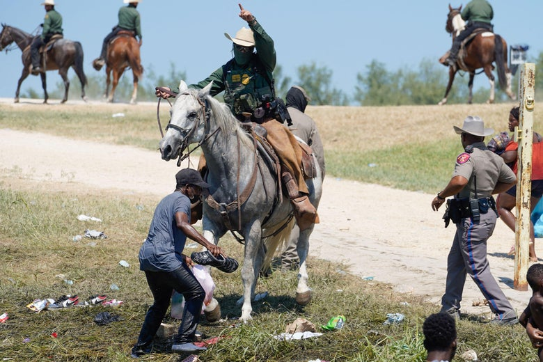Horse-mounted agent wields whip in border interaction.