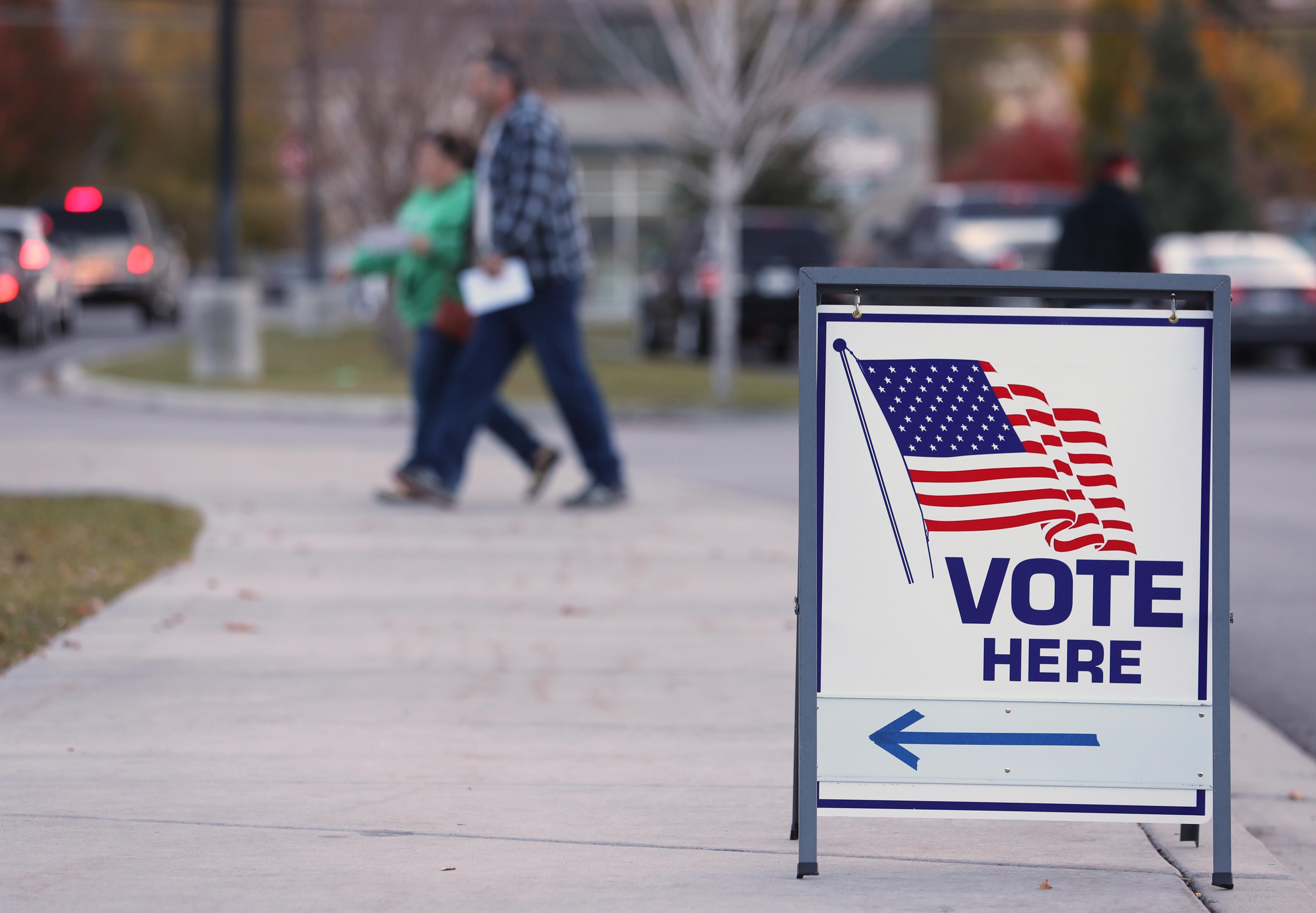 PROVO, UT - NOVEMBER 6: A couple walks into a polling center to vote in the midterm elections on November 6, 2018 in Provo, Utah. Utah early voting has been highest ever in Utah's midterm elections. One of the main proportions on the ballet in Utah is whether Utah will legalize medical marijuana.  (Photo by George Frey/Getty Images)