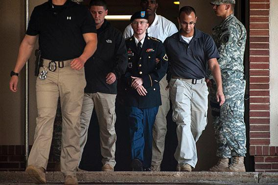Private First Class Bradley Manning is escorted out of court after testifying in the sentencing phase of his military trial at Fort Meade, Maryland August 14, 2013.