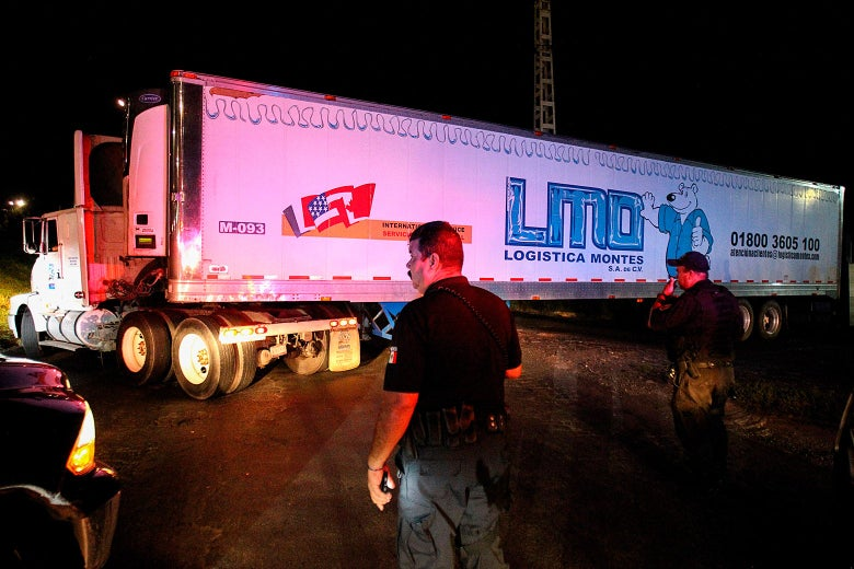 A trailer carrying more than 100 bodies of unidentified people is driven through the streets of Guadalajara.