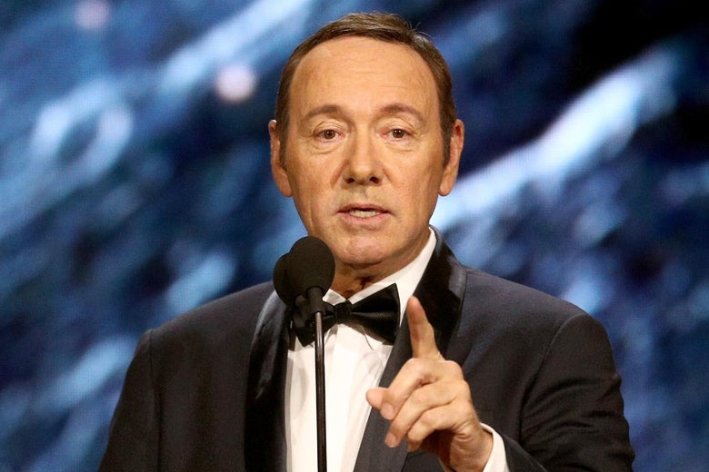 Kevin Spacey onstage in a tuxedo.