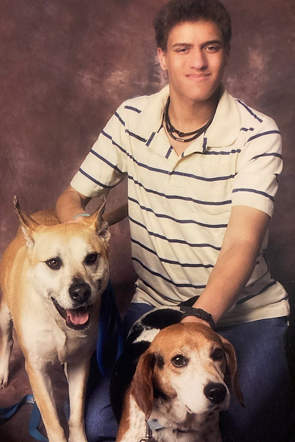 Jordan posing with his mutt Abby and beagle Jake.
