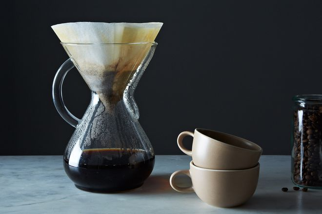 Pour over coffee, cups, and coffee beans in a jar