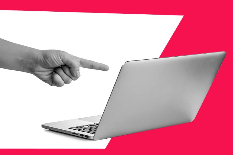 A woman's hand pointing at a laptop, directing a man to look at it.