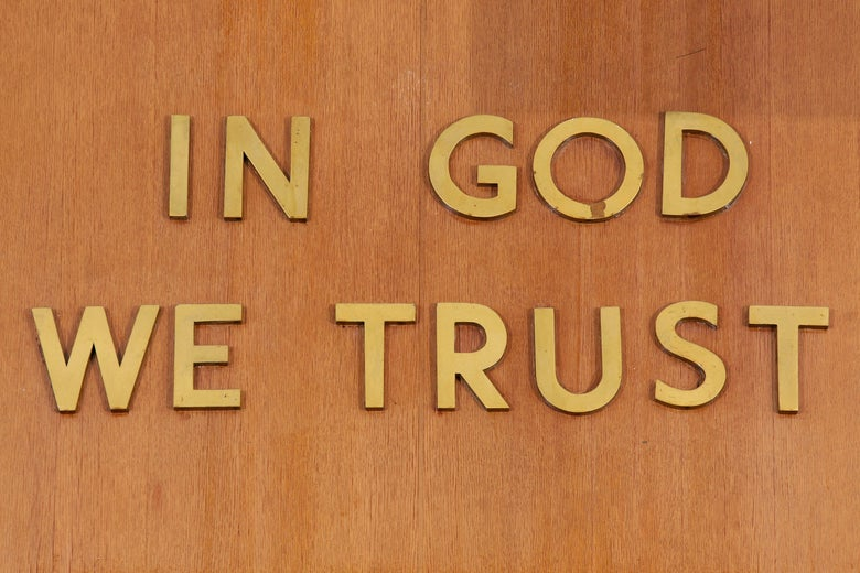 """In God We Trust"" is inscribed above the judge's chair at the New York State Supreme Court."