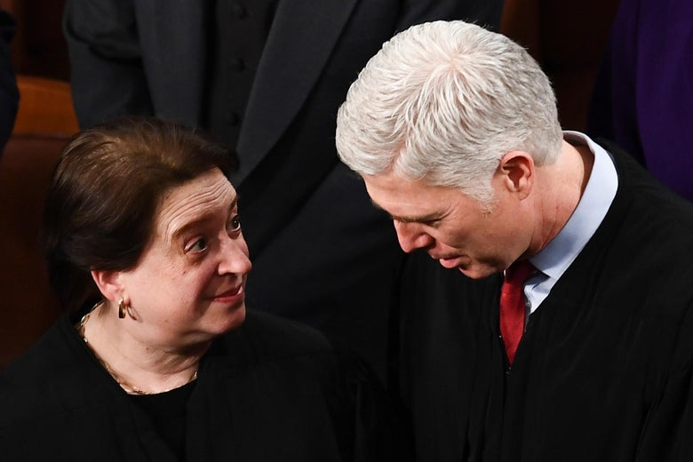 Gorsuch speaks to Kagan, both wearing their robes