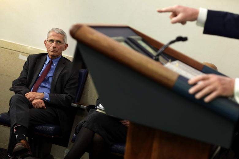 National Institute of Allergy and Infectious Diseases Director Anthony Fauci watches as President Donald Trump makes a point during the daily briefing of the White House Coronavirus Task Force in the James Brady Briefing Room April 10, 2020 at the White House in Washington, D.C.