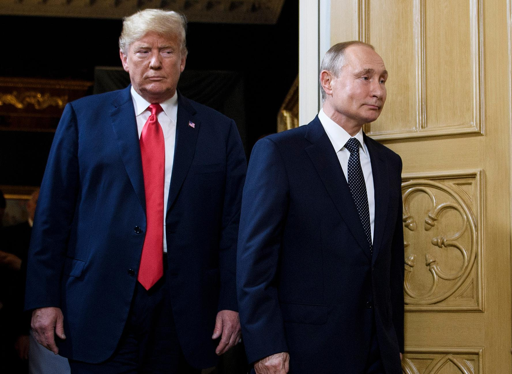 President Donald Trump and Russian President Vladimir Putin arrive for a meeting in Helsinki, on July 16, 2018.