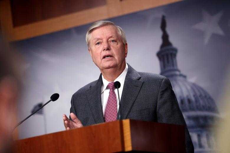 Graham speaks at a podium