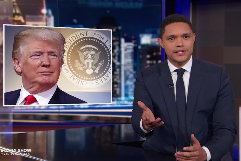 Trevor Noah with a picture of Donald Trump.