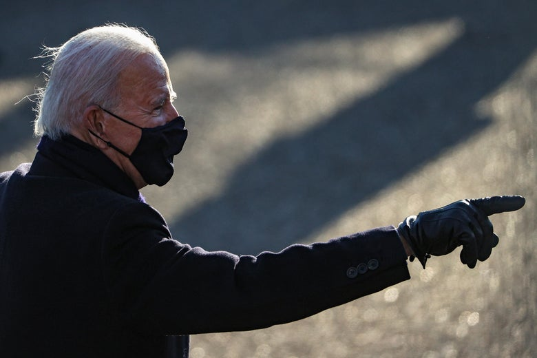 Biden energetically points at the crowd as he walks to the White House after the inauguration.